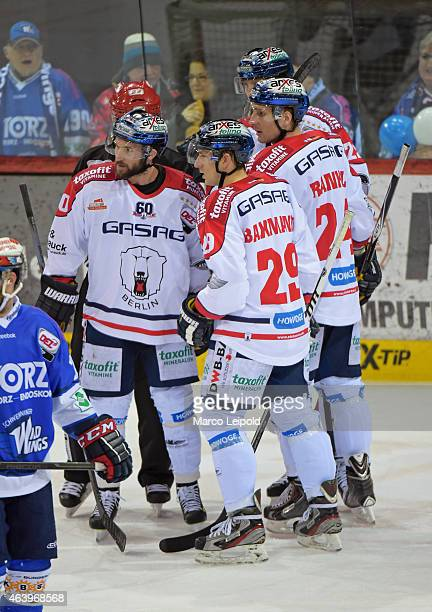 Darin Olver, Jens Baxmann and Andre Rankel of the Eisbaeren Berlin celebrate after scoring the 0:2 during the game between Schwenninger Wild Wings...