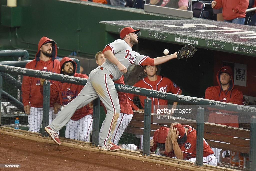Darin Ruf #18 of the Philadelphia Phillies can not catch a foul ball hit by Bryce Harper #34 of the Washington Nationals in the 12th inning during a baseball game at Nationals Park on September 26, 2015 in Washington, DC.