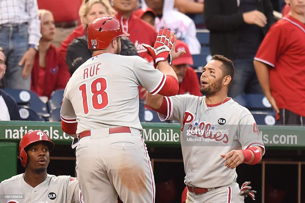 Darin Ruf #18 of the Philadelphia Phillies celebrates with Freddy Galvis #13 on Brian Bogusevic #17 (not pictured) double in the eight inning during a baseball game against the Washington Nationals at Nationals Park on September 26, 2015 in Washington, DC. The Nationals won 2-1 in the 12th inning