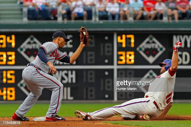 Darin Ruf of the Philadelphia Phillies steals second base as Andrelton Simmons of the Atlanta Braves takes the throw during a game at Citizens Bank...