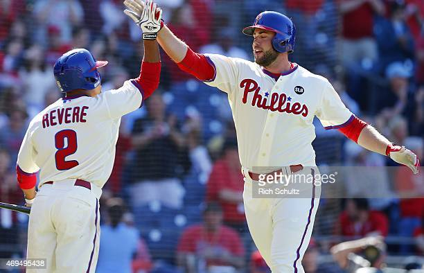 Darin Ruf right of the Philadelphia Phillies is congratulated by teammate Ben Revere after hitting a home run during the seventh inning of a game at...