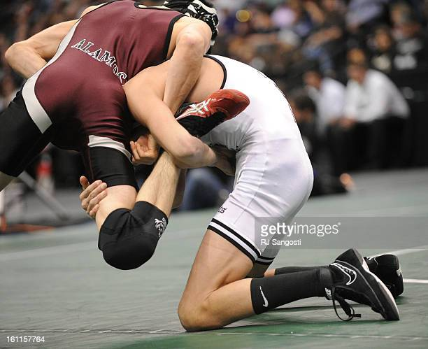 Darin Sisneros from Alamosa in maroon and black wrestles Timothy Urenda in white from Pueblo South in the 4A 112 lb match during the 2010 Colorado...