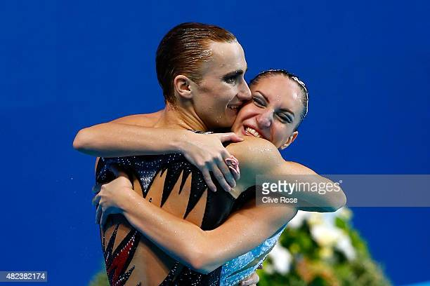 Darina Valitova and Aleksandr Maltsev of Russia celebrate after winning the gold medal in the Mixed Duet Free Synchronised Swimming Final on day six...