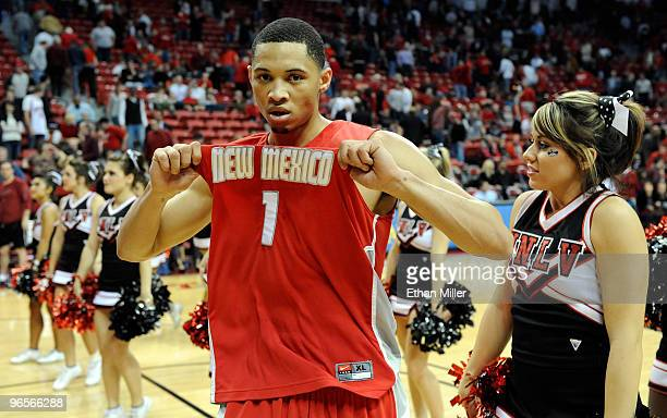 Darington Hobson of the New Mexico Lobos celebrates on the court in front of UNLV cheerleaders after the Lobos defeated the UNLV Rebels 76-66 at the...