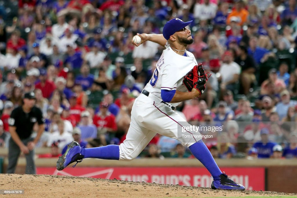 Dario Alvarez #39 of the Texas Rangers pitches against the Toronto Blue Jays in the top of the eighth inning at Globe Life Park in Arlington on June 21, 2017 in Arlington, Texas.
