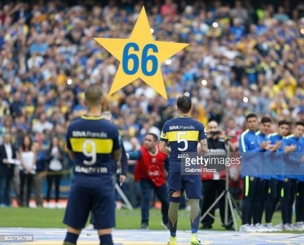 Dario Benedetto and Fernando Gago of Boca Juniors celebrate the Torneo Primera Division 2016/17 title prior a match between Boca Juniors and Union as...