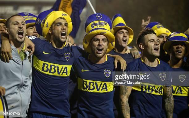 Dario Benedetto Emmanuel Mas Julio Buffarini and Nahitan Nández of Boca Juniors celebrate after winning the Superliga 2017/18 at Estadio Juan Carmelo...