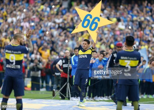 Dario Benedetto, Fernando Gago and Jonathan Silva of Boca Juniors celebrate the Torneo Primera Division 2016/17 title prior a match between Boca...