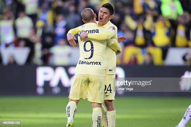 Dario Benedetto of America celebrates after scoring his team's third goal during a friendly match between America and Monterrey at BBVA Compass...