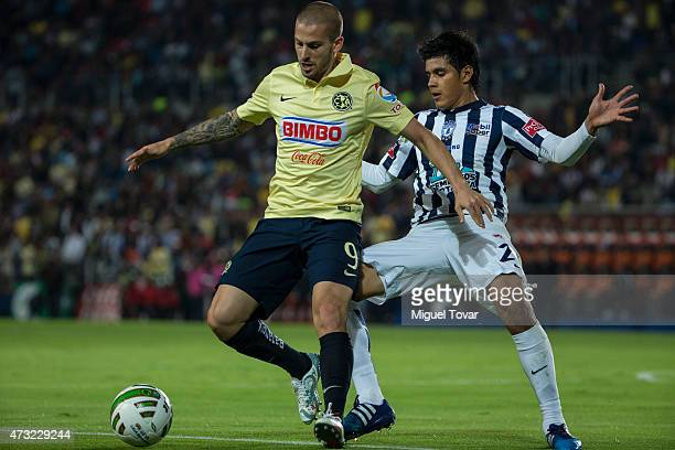 Dario Benedetto of America fights for the ball with Miguel Herrera of Pachuca during a quarterfinal first leg match between Pachuca and America as...