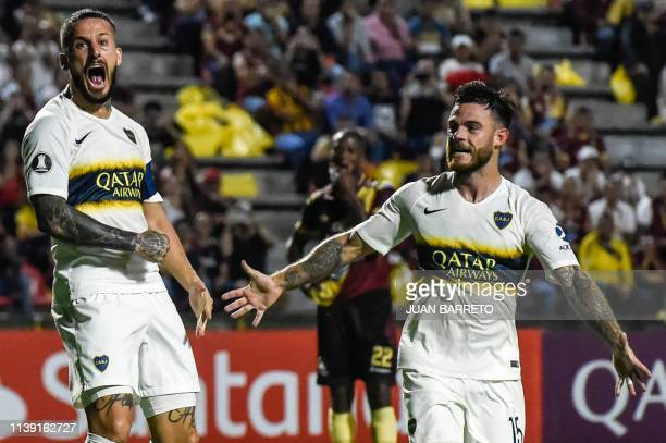 Dario Benedetto of Argentina's Boca Juniors celebrates with teammate Nahitan Nandez after scoring against Colombia's Deportes Tolima during their...