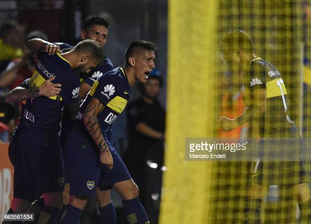 Dario Benedetto of Boca Juniors and teammates celebrate after scoring the first goal of his team during a match between Boca Juniors and Defensa y...