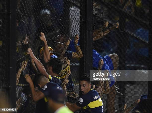 Dario Benedetto of Boca Juniors and teammates celebrate with fans after scoring the first goal of his team during a match between Boca Juniors and...