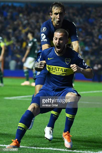 Dario Benedetto of Boca Juniors celebrates after scoring the first goal of his team with teammate Carlos Izquierdoz during the Semi Final firstleg...