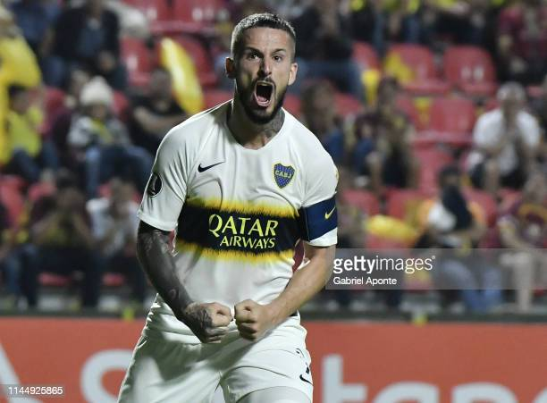 Dario Benedetto of Boca Juniors celebrates after scoring the second goal of his team via penalty during a group G match between Deportes Tolima and...