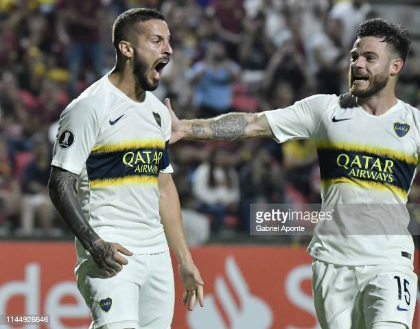 Dario Benedetto of Boca Juniors celebrates after scoring the second goal of his team with teammate Nahitan Nández during a group G match between...