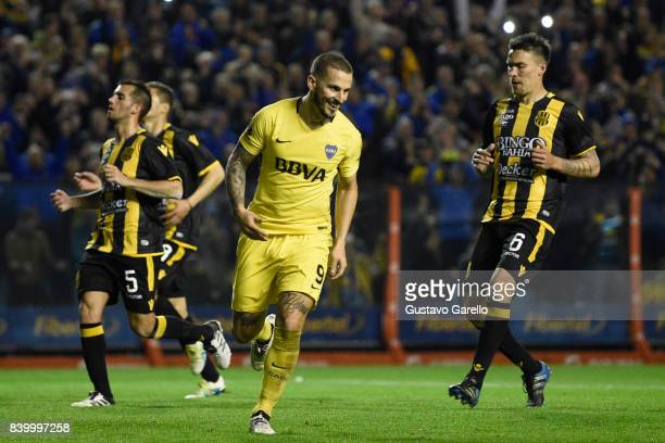 Dario Benedetto of Boca Juniors celebrates after scoring the third goal of his team during a match between Boca Juniors and Olimpo as part of...