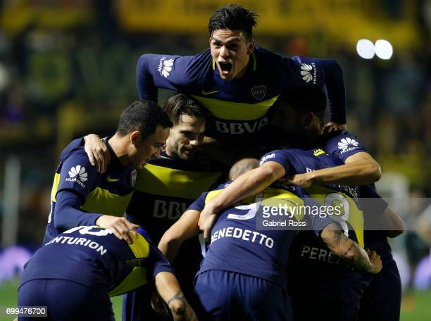 Dario Benedetto of Boca Juniors celebrates with Jonathan Silva Fernando Gago and teammates after scoring the second goal of his team during a match...