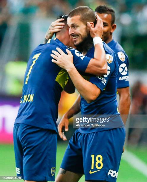 Dario Benedetto of Boca Juniors celebrates with teammate Cristian Pavon after scoring the second goal of his team during the match against Palmeiras...