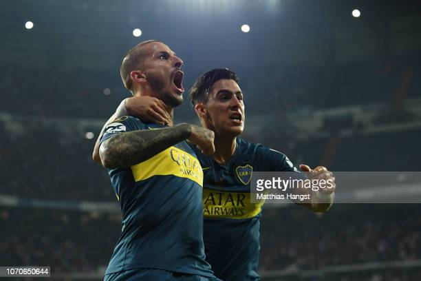 Dario Benedetto of Boca Juniors celebrates with teammate Cristian Pavon after scoring his team's first goal during the second leg of the final match...