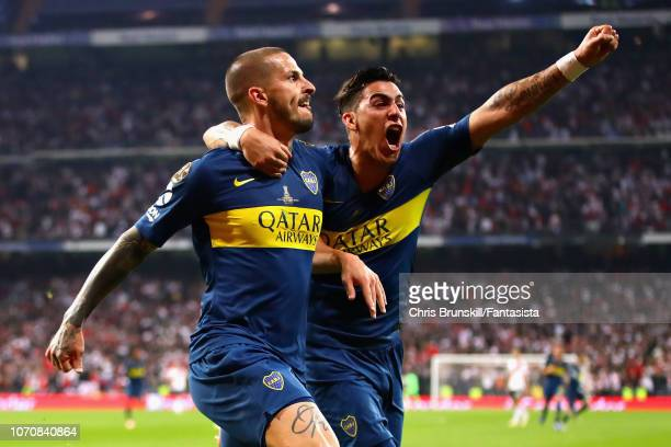 Dario Benedetto of Boca Juniors celebrates with teammate Cristian Pavon after scoring his sides first goal during the second leg of the final match...