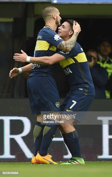 Dario Benedetto of Boca Juniors celebrates with teammate Cristian Pavon after scoring the first goal of his team during a match between Boca Juniors...