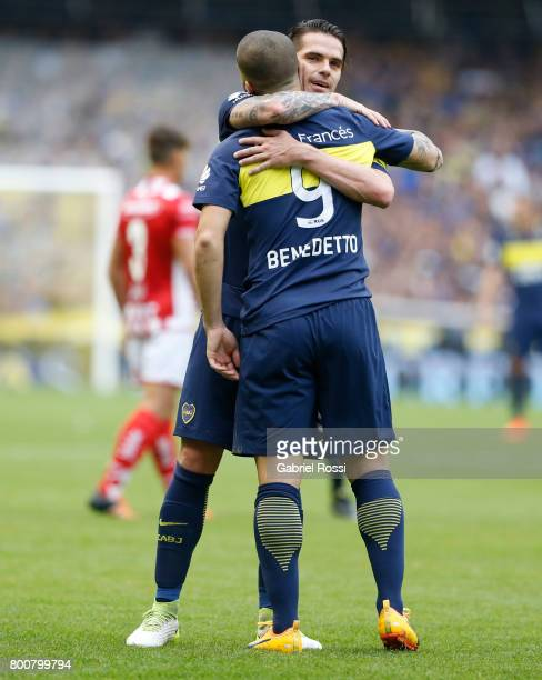 Dario Benedetto of Boca Juniors celebrates with teammate Fernando Gago after scoring the first goal of his team during a match between Boca Juniors...