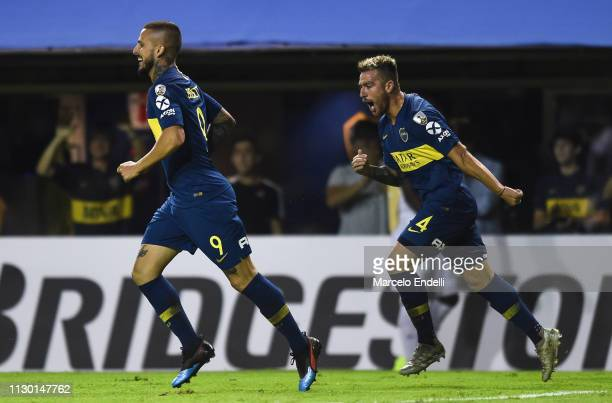 Dario Benedetto of Boca Juniors celebrates with teammate Julio Buffarini after scoring the second goal of his team during a group G match between...