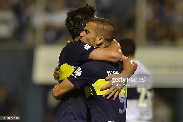 Dario Benedetto of Boca Juniors celebrates with teammate Pablo Perez after scoring the second goal of his team during a match between Gimnasia y...