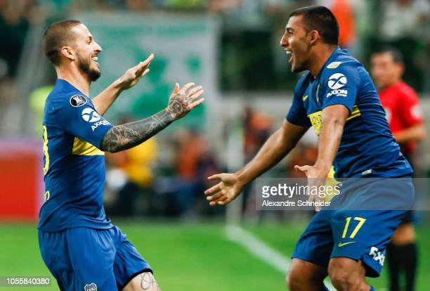 Dario Benedetto of Boca Juniors celebrates with teammate Ramon Abila after scoring the second goal of his team during the match against Palmeiras for...