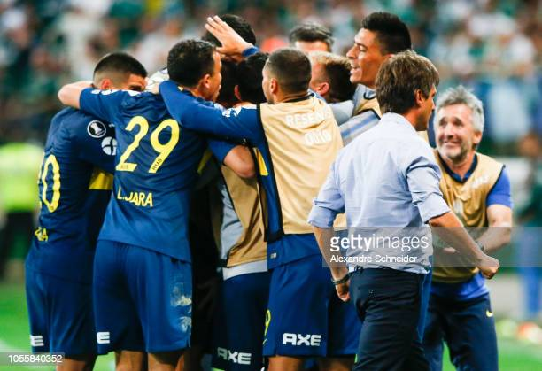 Dario Benedetto of Boca Juniors celebrates with teammates after scoring the second goal of his team during the match against Palmeiras for the Copa...