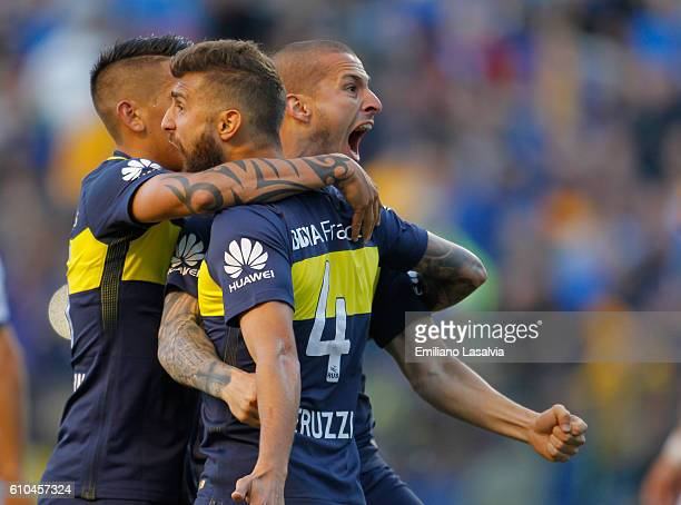 Dario Benedetto of Boca Juniors celebrates with teammates after scoring the opening goal during a match between Boca Juniors and Quilmes as part of...