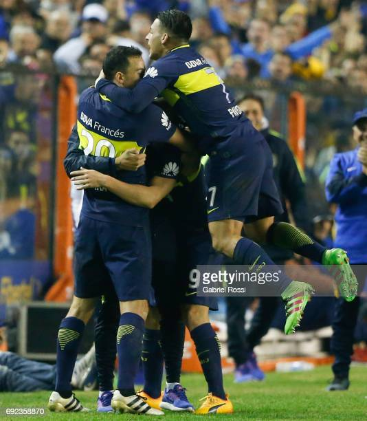 Dario Benedetto of Boca Juniors celebrates with teammates after scoring the third goal of his team during a match between Boca Juniors and...