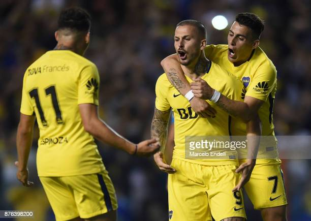 Dario Benedetto of Boca Juniors celebrates with teammates after scoring the first goal of his team during a match between Boca Juniors and Racing...
