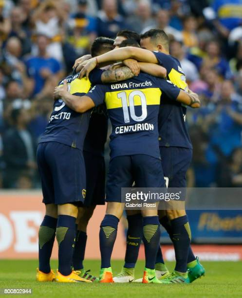 Dario Benedetto of Boca Juniors celebrates with teammates Cristian Pavon and Ricardo Centurion after scoring the second goal of his team during a...