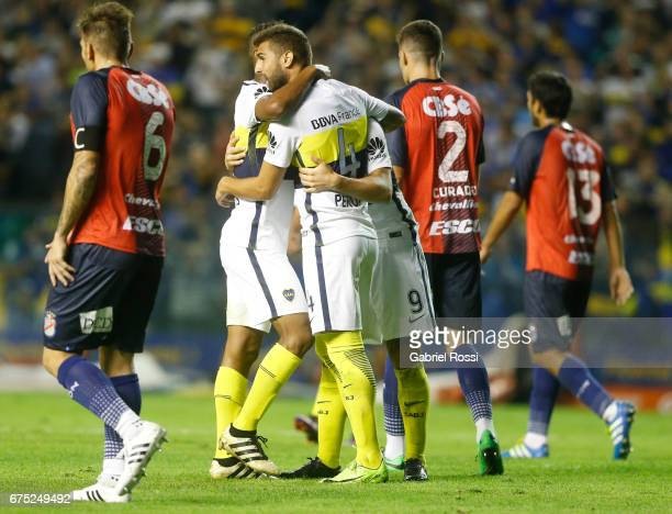 Dario Benedetto of Boca Juniors celebrates with teammates Gino Peruzzi and Rodrigo Bentancur after scoring the second goal of his team during a match...