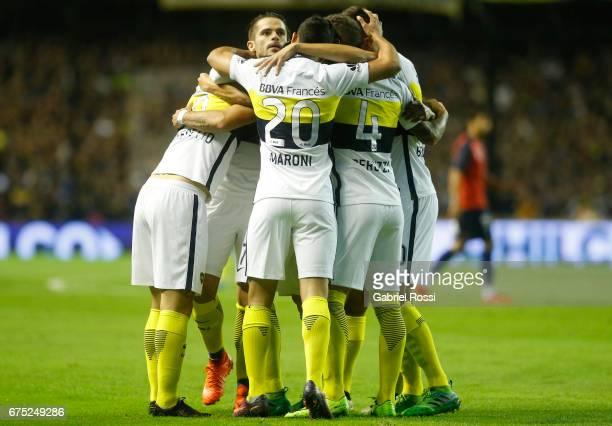 Dario Benedetto of Boca Juniors celebrates with teammates Gonzalo Maroni Fernando Gago and Gino Peruzzi after scoring the first goal of his team...
