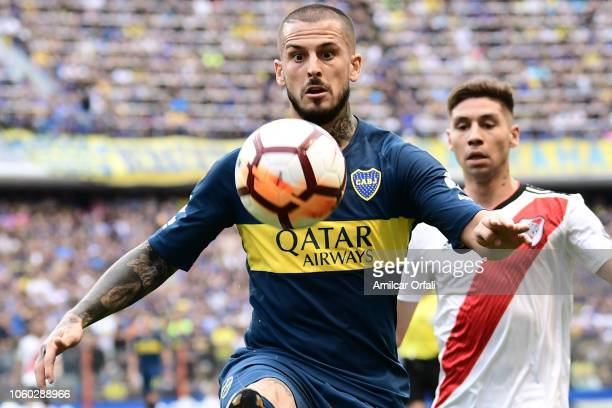 Dario Benedetto of Boca Juniors controls the ball during the first leg match between Boca Juniors and River Plate as part of the Finals of Copa...