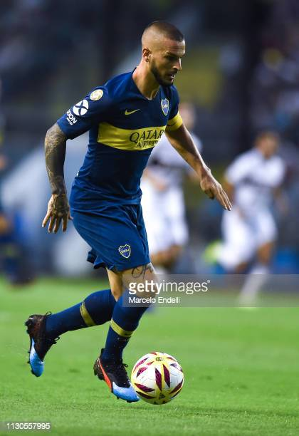 Dario Benedetto of Boca Juniors drives the ball during a match between Boca Juniors and Lanus as part of Superliga 2018/19 at Estadio Alberto J...