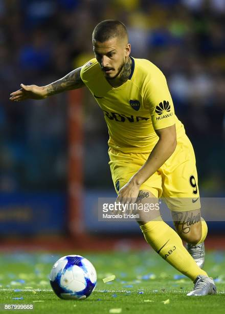 Dario Benedetto of Boca Juniors drives the ball during a match between Boca Juniors and Belgrano as part of Superliga 2017/18 at Alberto J Armando...