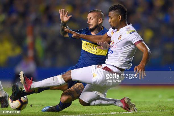 Dario Benedetto of Boca Juniors fights for the ball with Danovis Banguero of Deportes Tolima during a group G match between Boca Juniors and Deportes...