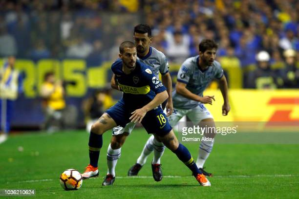 Dario Benedetto of Boca Juniors fights for the ball with Edilson of Cruzeiro during a Quarter Final first leg match between Boca Juniors and Cruzeiro...