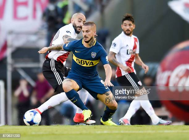 Dario Benedetto of Boca Juniors fights for the ball with Javier Pinola of River Plate during a match between River Plate and Boca Juniors as part of...