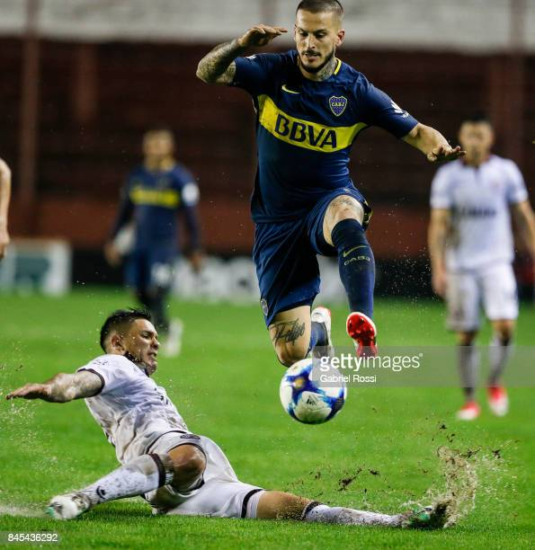 Dario Benedetto of Boca Juniors fights for the ball with Luis Herrera of Lanus during a match between Lanus and Boca Juniors as part of the Superliga...