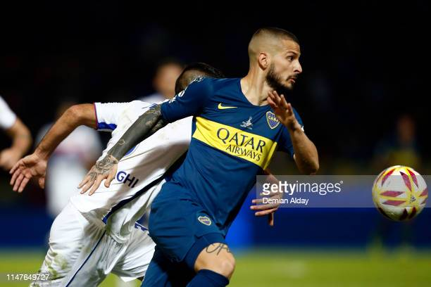 Dario Benedetto of Boca Juniors fights for the ball with Néstor Moiraghi of Tigre during the final match of Copa de la Superliga 2019 between Boca...