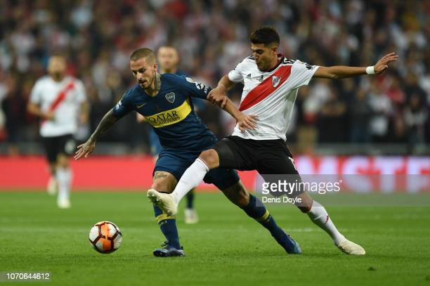 Dario Benedetto of Boca Juniors is challenged by Exequiel Palacios of River Plate during the second leg of the final match of Copa CONMEBOL...
