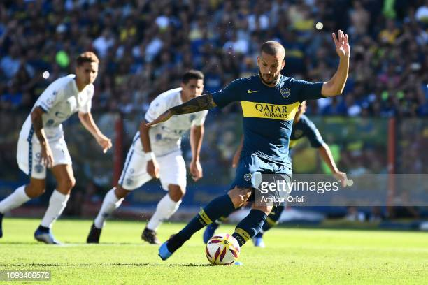 Dario Benedetto of Boca Juniors kicks a penalty to score the first goal of his team during a match between Boca Juniors and Godoy Cruz as part of...