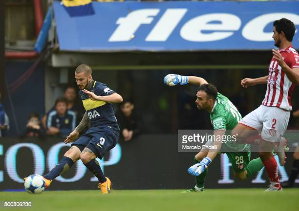 Dario Benedetto of Boca Juniors kicks the ball to score the first goal of his team during a match between Boca Juniors and Union as part of Torneo...