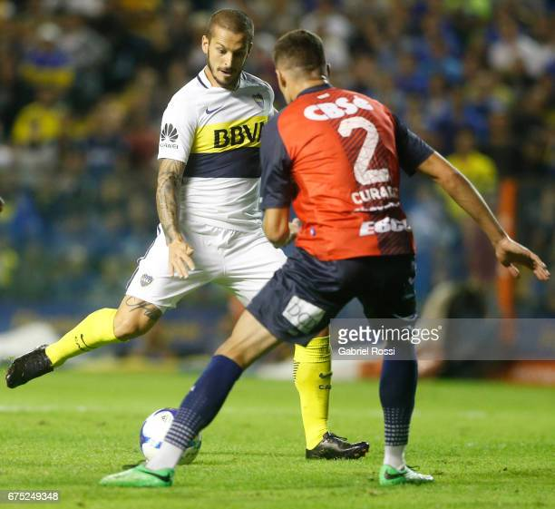 Dario Benedetto of Boca Juniors kicks the ball to score the second goal of his team during a match between Boca Juniors and Arsenal as part of Torneo...