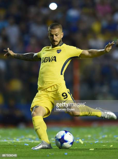 Dario Benedetto of Boca Juniors kicks the ball to score the third goal of his team during a match between Boca Juniors and Belgrano as part of...